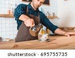 selective focus of barista... | Shutterstock . vector #695755735