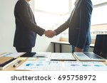 two business men shaking hands... | Shutterstock . vector #695758972