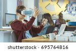 Small photo of In a Computer Science Class Boy Wearing Virtual Reality Headset Works on a Programing Project.