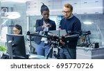 caucasian male and black female ... | Shutterstock . vector #695770726