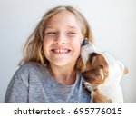 happy child with dog. portrait... | Shutterstock . vector #695776015