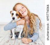 happy child with dog. portrait... | Shutterstock . vector #695776066