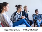 woman speaking in group therapy ... | Shutterstock . vector #695795602