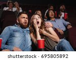 shocked young couple watching a ... | Shutterstock . vector #695805892