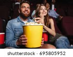 happy smiling couple holding a... | Shutterstock . vector #695805952