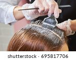 hair dying close up. brush...   Shutterstock . vector #695817706