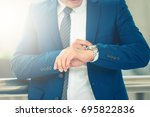 busy businessman looking at... | Shutterstock . vector #695822836