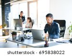 three business people in the... | Shutterstock . vector #695838022
