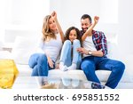 young parents siting on the... | Shutterstock . vector #695851552