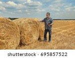 Farmer In Wheat Field After...
