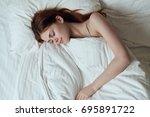 woman sleeping in bed           ... | Shutterstock . vector #695891722