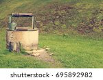 old well with metal bucket in... | Shutterstock . vector #695892982