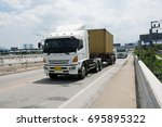 container truck in container... | Shutterstock . vector #695895322