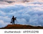 photographer shooting natural... | Shutterstock . vector #695910298