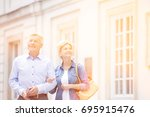 happy middle aged couple... | Shutterstock . vector #695915476