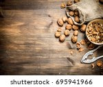 shelled walnuts. on a wooden... | Shutterstock . vector #695941966
