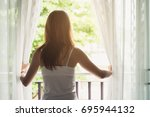 young asian woman opening... | Shutterstock . vector #695944132