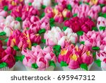 cupcakes frosted using russian... | Shutterstock . vector #695947312