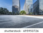 empty road with modern business ... | Shutterstock . vector #695953726
