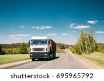 truck in motion on country road.... | Shutterstock . vector #695965792