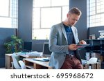 confident young businessman... | Shutterstock . vector #695968672
