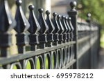 wrought iron fence | Shutterstock . vector #695978212