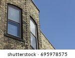 stone apartment windows | Shutterstock . vector #695978575