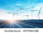 wind turbines on windy and... | Shutterstock . vector #695984188