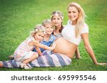 mother of many children  cute... | Shutterstock . vector #695995546