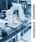 industrial robot with conveyor... | Shutterstock . vector #696000082