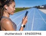 running music motivation woman... | Shutterstock . vector #696000946