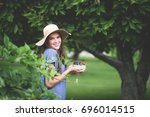 beautiful girl with bowl of... | Shutterstock . vector #696014515