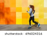 side view of female athlete... | Shutterstock . vector #696024316