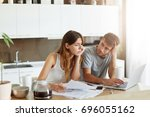 caucasian couple going to buy... | Shutterstock . vector #696055162