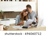 frustrated woman studying sheet ... | Shutterstock . vector #696060712