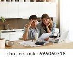 unhappy american couple... | Shutterstock . vector #696060718