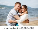happy family mother  father and ... | Shutterstock . vector #696084082