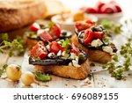 bruschetta with grilled...   Shutterstock . vector #696089155