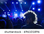 silhouettes of concert crowd... | Shutterstock . vector #696101896
