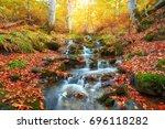 autumn creek woods with yellow...   Shutterstock . vector #696118282