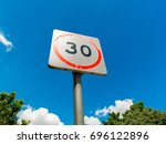 speed limit sign with clear sky ... | Shutterstock . vector #696122896