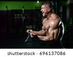 brutal strong athletic men... | Shutterstock . vector #696137086