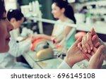 closeup of woman hands... | Shutterstock . vector #696145108