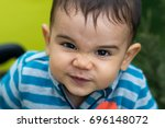 cute baby boy making an angry... | Shutterstock . vector #696148072