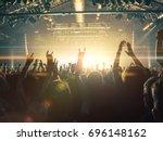 concert crowd attending a... | Shutterstock . vector #696148162