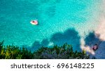 woman relaxing on inflatable... | Shutterstock . vector #696148225