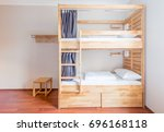 Stock photo hostel dormitory beds arranged in room 696168118