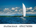 White Sailboat On Lake...