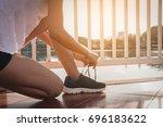 healthy woman doing exercises... | Shutterstock . vector #696183622