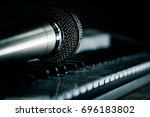 the vocal microphone piano keys | Shutterstock . vector #696183802